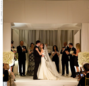 A dramatic huppah set the scene for Alison and Greg's Jewish ceremony. The thickly draped structure demanded attention.