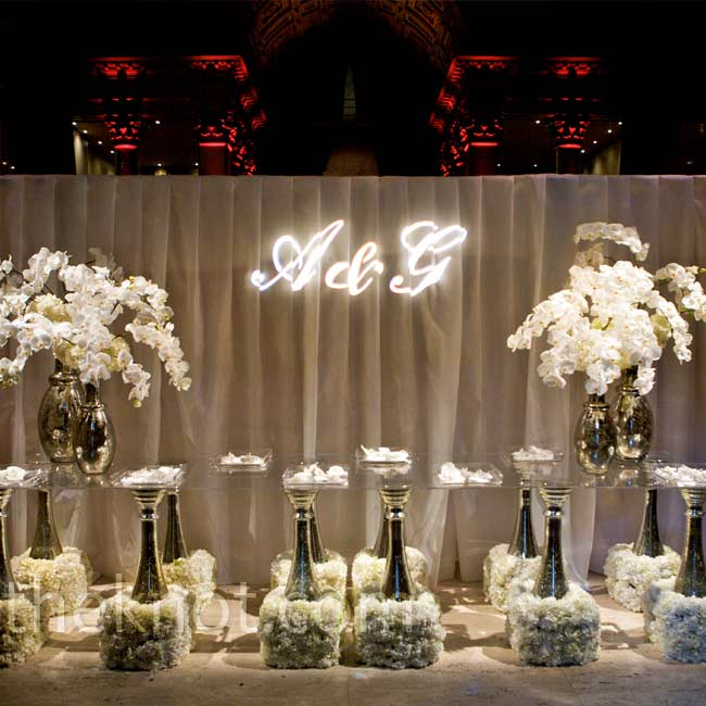 Gobo lighting added texture to the vast space, while tall centerpieces complemented the high ceilings.
