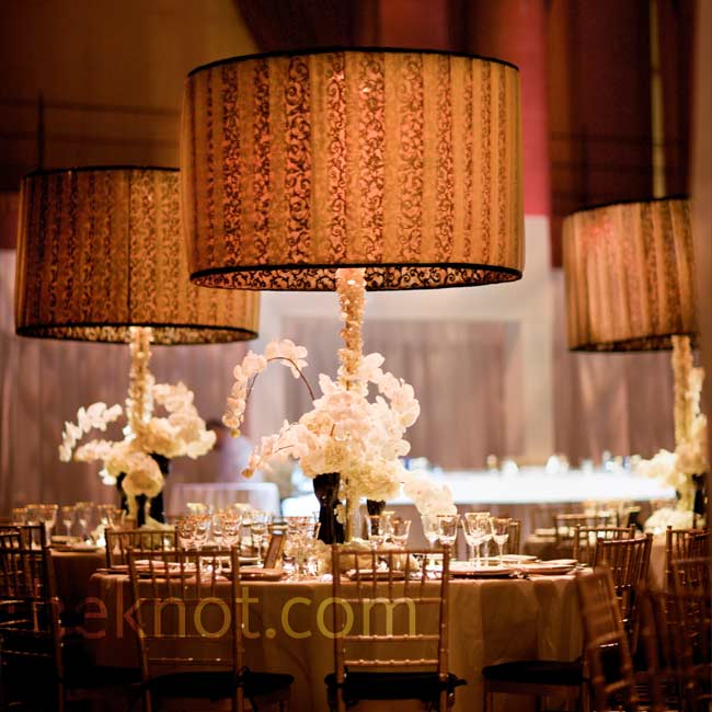 Dramatic lampshades topped off arrangements of orchids. LED lights lit them up from within.