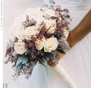 Purple seeded eucalyptus gave Rebecca's bouquet of white roses an earthy edge. It also brought out the wedding palette.