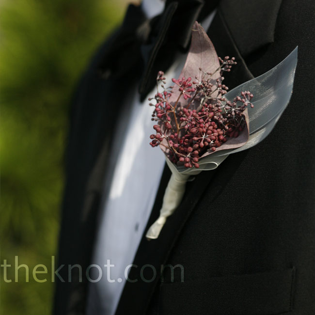 Stems of purple and green seeded eucalyptus added a touch of color to the groom's black-and-white attire. They also coordinated with the bride's bouquet.