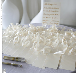 Instead of a sign-in book, guests wrote messages on damask-printed cards. These were then hung on a wishing tree, which served as additional décor.