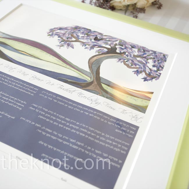 The couple's ketubah, the Jewish marriage contract, had the signature color in it. After the couple signed it, they displayed it under their huppah.