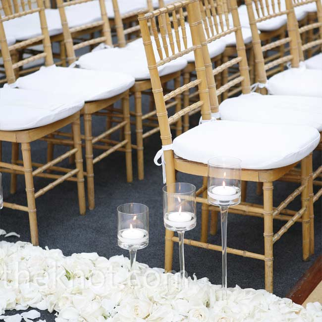 Floating candles and hundreds of rose heads and petals gave the aisle a romantic look.