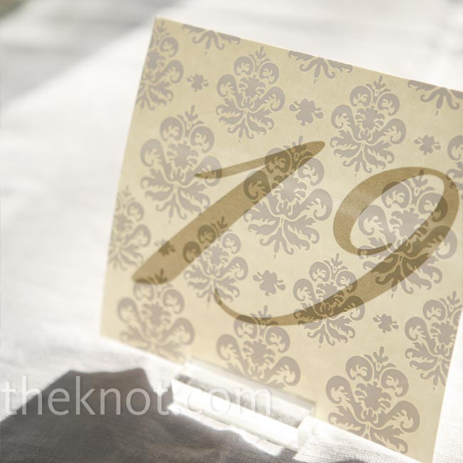 You'd never know it, but the table cards were a DIY project. The bride used damask-patterned paper left over from the invitations and printed numbers on them from home.