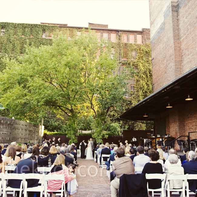"Shelly and Todd married in an interfaith ceremony on the outdoor patio of the Hobbs. The pastor and rabbi worked together to make the ceremony unique, personal, and ""cliche-free."" The couple stood beneath a huppah made of four maple saplings from which they draped with the groom's grandfather's tallis. Following the honeymoon, the couple planted th ..."
