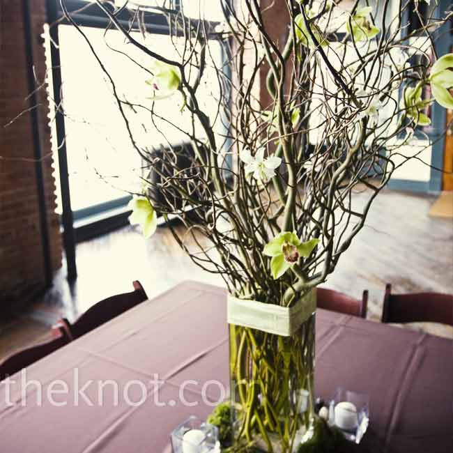 On other tables at Shelly and Todd's reception, curly willow and green cymbidium orchids were arranged in centerpieces of varying heights. The organic look of the centerpieces was a dramatic counterpoint to the urban, loft-like reception space.