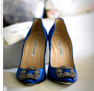 To tie in with the blue, silver, and white theme, Kate wore blue Manolo Blahnik Something Blue satin pumps with her gown.
