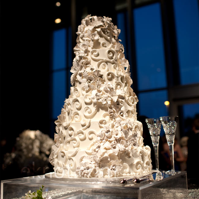 Kate wanted an extremely elegant centerpiece for the reception, so she designed a six-tiered cake with sugar flowers and fondant swirls. It was displayed on a clear Lucite table in the center of the room.