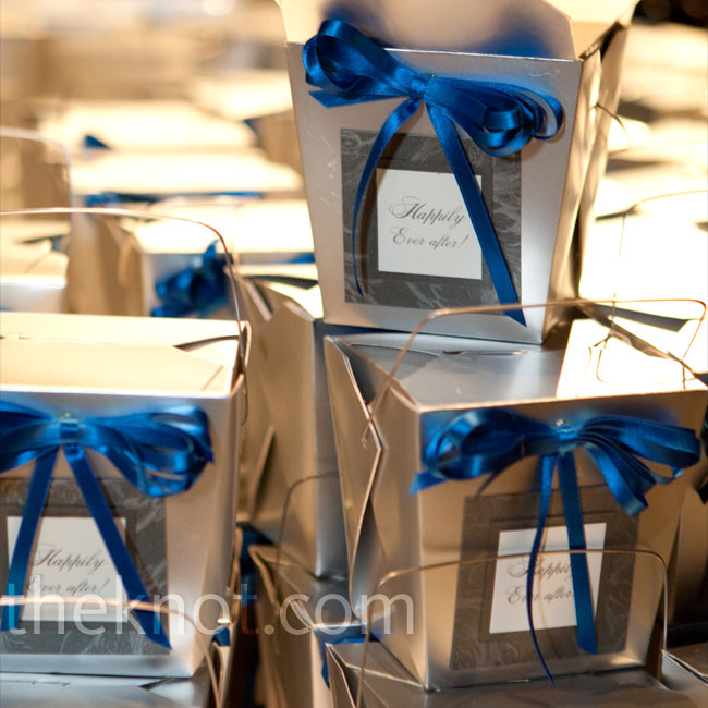 Instead of placing the favors at each seat, where guests would have had to keep track of them all evening, Kate had the silver boxes of chocolates and mints placed on a table near the exit.