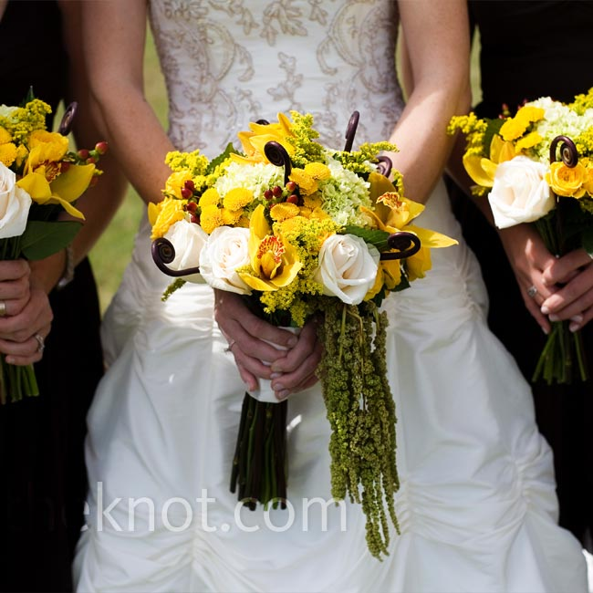 """I really wanted my flowers to look like I just grabbed some wild flowers on the way to my wedding,"" Holly explains. So the florist put together a bouquet of brown hypericum berries, green mini hydrangeas, yellow spray roses, mums, solidago, cymbidium orchids, ferns, and hanging amaranthus."