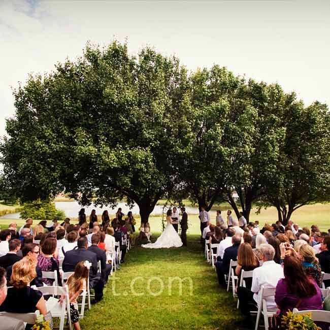 "Holly and Brian exchanged vows under a few trees in an open field. ""We decided to stick with very traditional vows because we felt that there was something to be said for saying the same thing as so many people before us,"" say Holly."