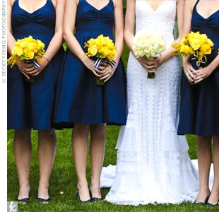 Jenn chose a dress that flattered all of her bridesmaids. The ladies loved the pockets which were perfect for carrying tissues, lip gloss, and cameras. Bright yellow bouquets of roses, orchids, and craspedia popped against the dark navy dresses.