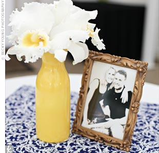 Jenn incorporated yellow, her favorite color, into the classic white-and-navy nautical look by using vintage vases and vibrant floral designs.