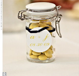 Guests took home glass jars filled with yellow M&Ms as favors. Jenn found the jars at World Market and personalized them with the couple's initials and wedding date.