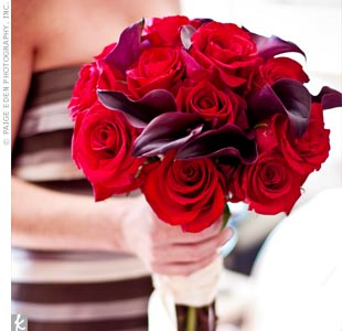 Here, a bridesmaid holds Kiera's bouquet. Kiera wanted her flowers to reflect the deep reds and chocolate browns in her wedding decor. She carried a bouquet of gorgeous black magic roses and deep purple calla lilies.