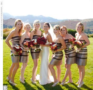 """This was my favorite part of the wedding attire,"" says Kiera. Her six bridesmaids wore fun, sleeveless dresses with horizontal layers in black, silver, and cream."