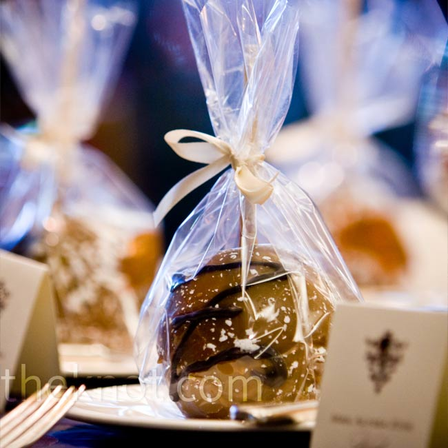 Each guest took home a tasty chocolate-covered candy apple, personalized with the couple's monogram.
