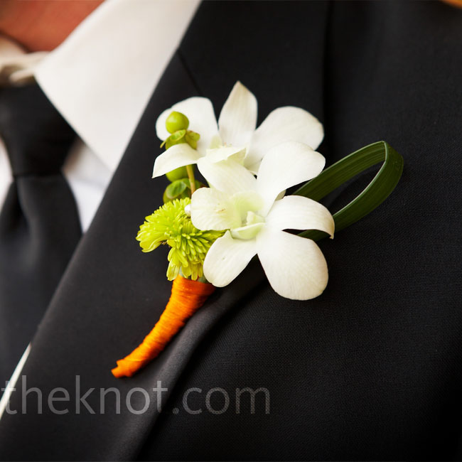 The groomsmen's boutonnieres mimicked the bouquets with lime cymbidium orchids wrapped in orange ribbon.