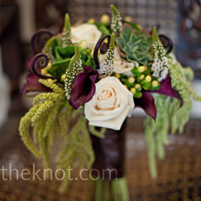 Lauren carried a bouquet of fiddlehead ferns, succulents, and deep-purple calla lilies for a soft, natural look. The ferns were what she'd specifically wanted, but she ended up liking the succulents most!