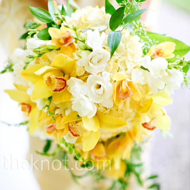Even though Sonya and Eoin changed florists three weeks before the wedding, Sonya got exactly the look she wanted for her bouquet: a natural-looking mix of cymbidium orchids, freesia, and Italian ruscus.