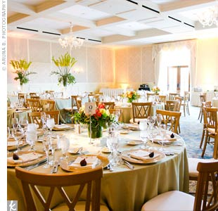 Pale green linens, gold chargers, and the hotel's cream dinner plates exuded the elegance, while the various centerpieces on the tables added just the right amount of vibrant energy.