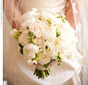 Various-shaped flowers, like freesia, lisianthus, and roses gave Jennifer's all-white bouquet lots of texture.