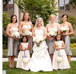 "The gorgeous, gold and steel-colored Anna Elyse bridesmaid dresses inspred the wedding color palette. ""I received more compliments on the bridesmaids' dresses than any other part of the wedding,"" says Jennifer."