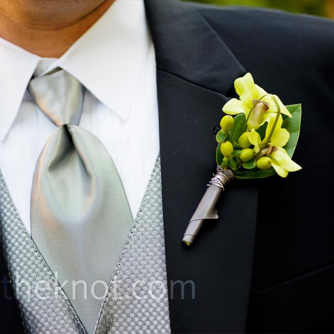 Green cymbidium orchids, nestled among hypericum berries, gave the guys a burst of color against their sleek, black jackets.
