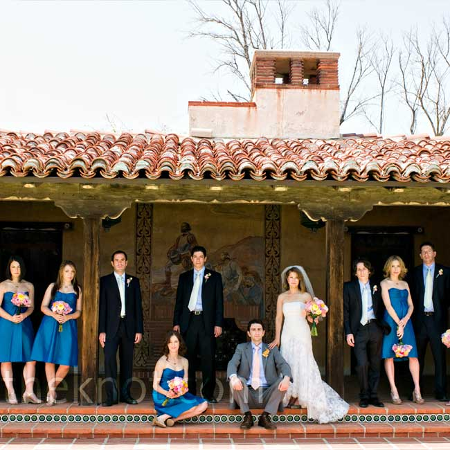 The couple worked lots of color into the wedding party outfits: Groomsmen wore matching green ties (and socks) with navy blue suits, Jared stood out in an orange tie and gray suit, and the girls' bright-blue dresses paired nicely with their pink and orange bouquets.