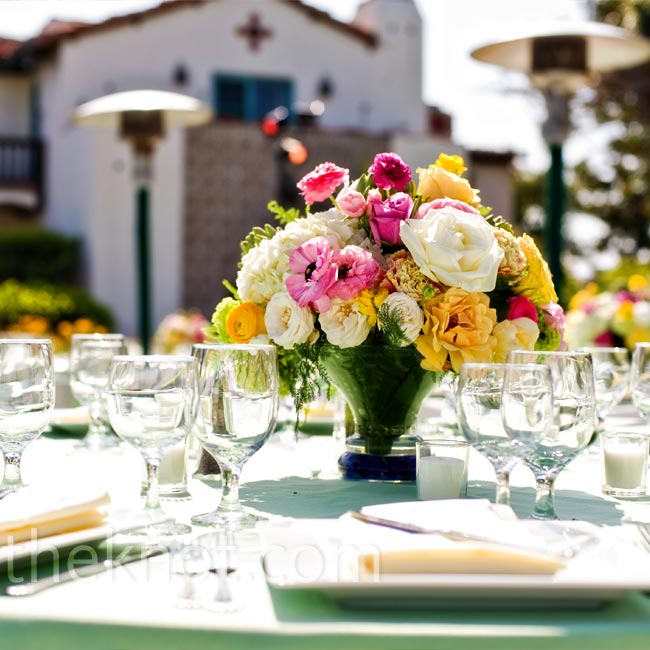 Like the bouquets, the centerpieces were made up of locally grown ranunculus, peonies, English roses, and hydrangea.