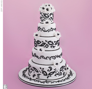 Five-tiered black-and-white wedding cake accented with black fondant cut-outs and sugar-made anemones.