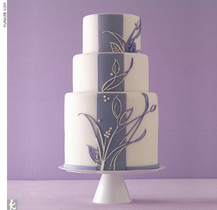 Three-tiered white wedding cake with graphic purple lilac details.