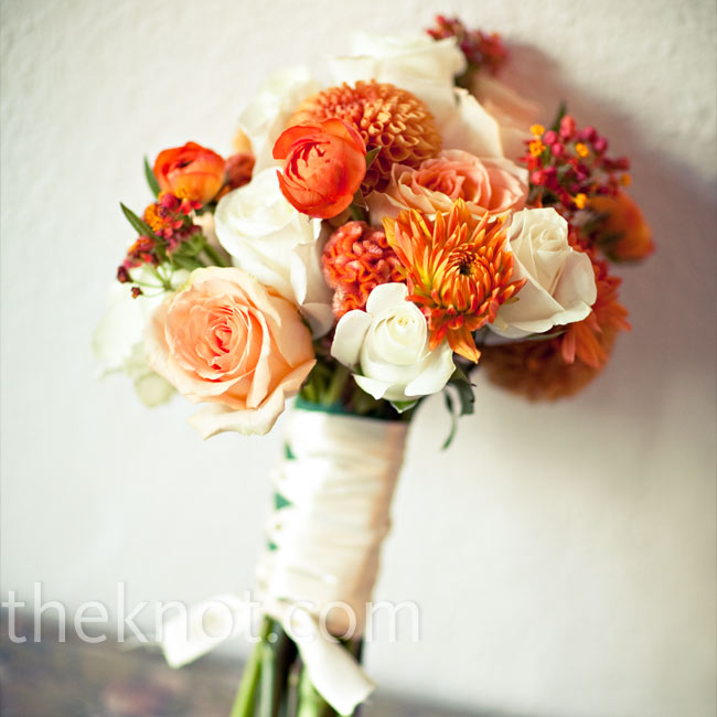 Adrienne carried a white, cream, and orange bouquet of dahlias (they're in-season during the fall) and roses packed tightly and wrapped with brown ribbon.