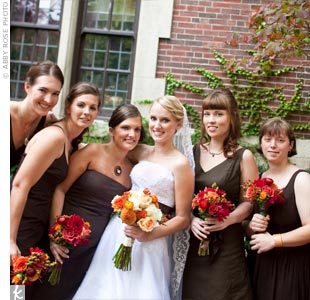 Adriennes bridesmaids all wore tea-length chocolate-brown dresses from J. Crew in the style they liked best. They accessorized with necklaces from Adrienne and Scott -- each got a different one that matched her personality.