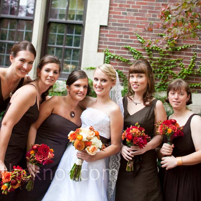 Adrienne's bridesmaids all wore tea-length chocolate-brown dresses from J. Crew in the style they liked best. They accessorized with necklaces from Adrienne and Scott -- each got a different one that matched her personality.