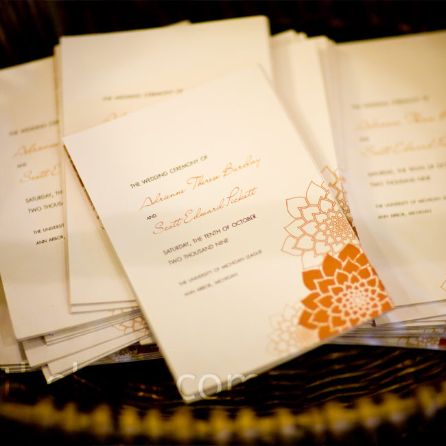 An orange dahlia inspired Adrienne and Scott's invitations and programs. The couple kept their design simple by using dahlias as the only visual element of the design.