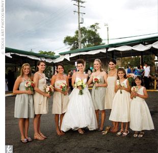 All the bridesmaids wore pewter and champagne dresses in various styles to serve as a base for the colorful flowers they carried.