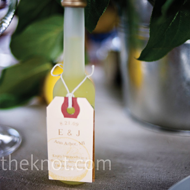 As a fresh summer favor, Elizabeth and Joel gave out tiny bottles of limoncello, for which she made favor tags that included the couple's initials.