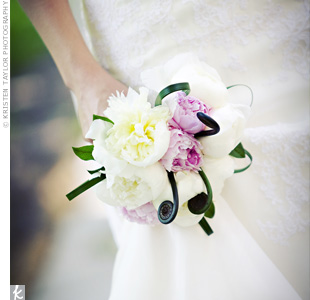 In her own bouquet, Kelly carried soft pink and ivory peonies with fiddlehead ferns.