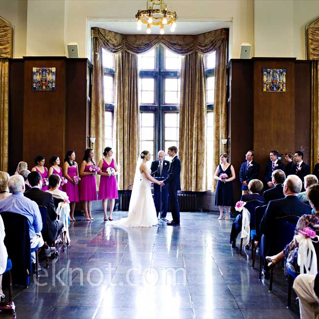 To create some sort of an altar space for their ceremony in the Pendleton Room of the University of Michigan Student Union, Kelly and Dave stood in front of one of the tall window bays. They decorated with three bouquets of pink peonies on either side of the aisle.