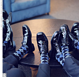 Greg and Lisa gave the groomsmen black-and-blue argyle socks to wear at the wedding. They added a bright pop of color to the guys' looks.