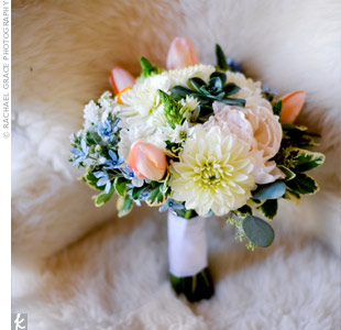The floral designer contrasted the soft look of dahlias, peonies, and tulips with hearty green succulents for the unique look Amy wanted.