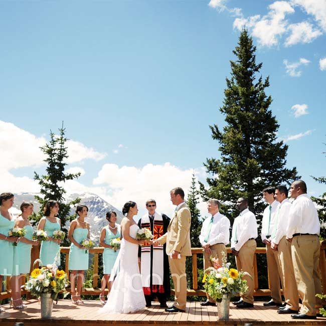 The bride and groom exchanged vows at a log altar surrounded by an amazing panoramic view of the mountains.