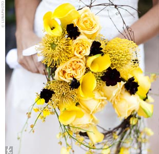 Jessica carried a vibrant combination of yellow calla lilies, roses, spider mums, and chocolate cosmos in a gorgeous asymmetrical bouquet wrapped with twisted grapevine.
