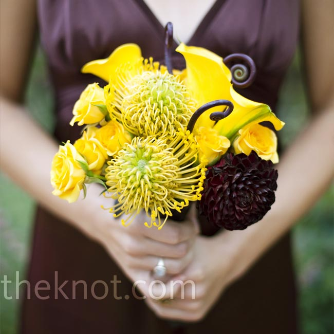 The ladies carried small round bouquets similar to the bride's. The arrangements were accented with large fiddlehead ferns.