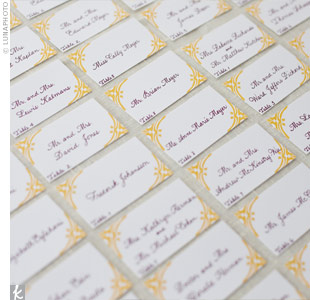 The escort cards matched the wedding stationery, with a decorative border and an Aspen leaf motif.
