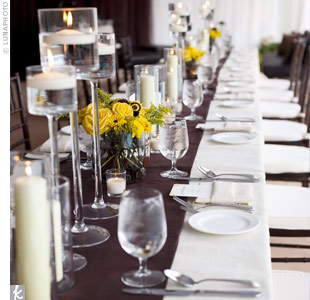 Guests sat at long tables covered in ivory linens and chocolate-brown runners. Small centerpieces, reminiscent of the bridal bouquet, added bursts of color to the tables.