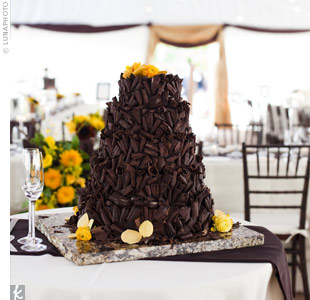 Delicious chocolate curls covered the couple's rich peanut butter chocolate cake. A cluster of fresh yellow flowers served as the topper.