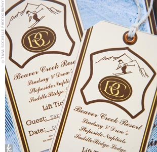 Drew put his graphic design skills to work and made the invitations to look like vintage ski lift tickets. The couple sent out leather portfolios containing the tickets and everything guests would need for the destination wedding.